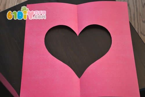 把一张红色纸正方形纸对折剪一个爱心